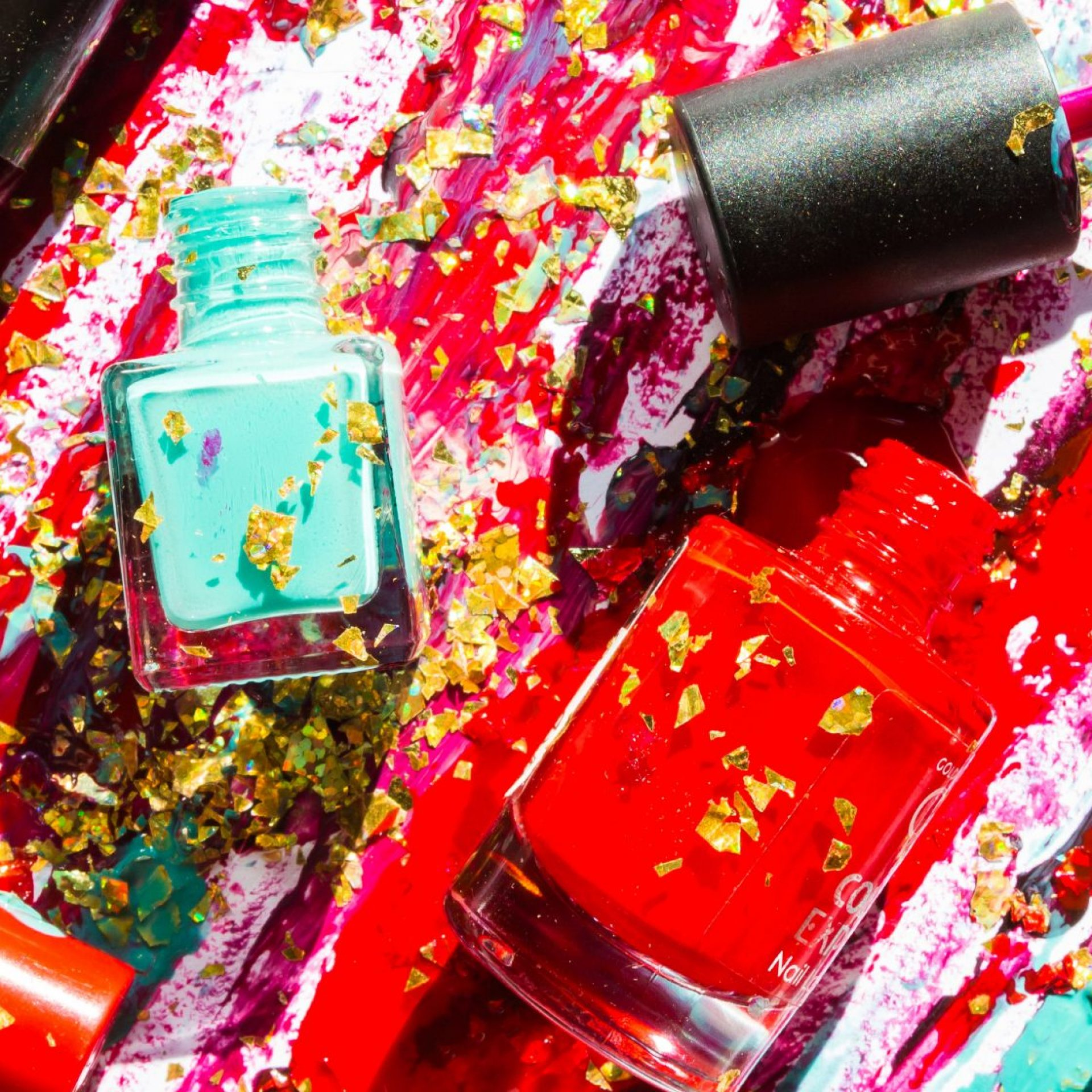 Colorful nail lacquer ads, nail polish splatter on white background